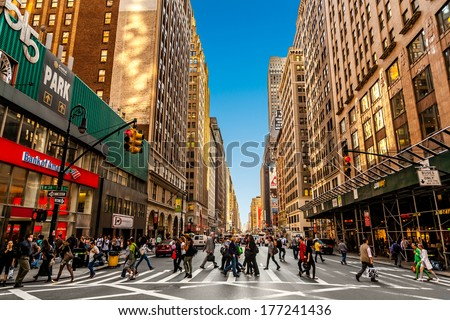 NEW YORK, USA - SEPTEMBER 21: Unidentified people on the street/avenue of New York City on September 21, 2013 - stock photo