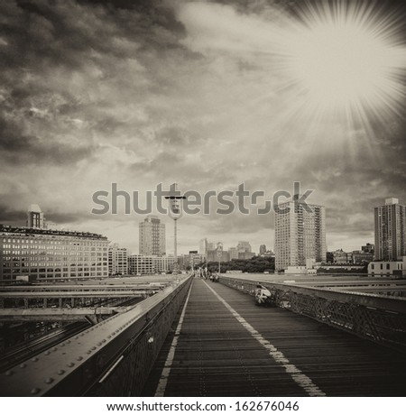 New York, USA. Southern side of Brooklyn Bridge as seen at sunset. - stock photo