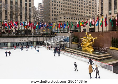 NEW YORK, USA / 08.02.2015 - Unknown people skating on ice ring at Rockefeller Center