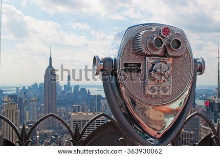 New York: view of Manhattan skyline, Empire State Building and Top of the Rock binocular on September 16, 2014. The first observation deck inauguration date of Top of the Rock was the spring of 1933 - stock photo