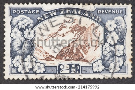 NEW ZEALAND - CIRCA 1935: A Cancelled postage stamp from New Zealand illustrating Mount Cook, issued in 1935. - stock photo