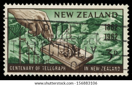 NEW ZEALAND - CIRCA 1962: A stamp printed in New Zealand honoring Centenary of the telegraph service in New Zealand, shows a hand operating an early morse key, circa 1962  - stock photo