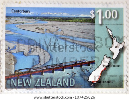 NEW ZEALAND - CIRCA 1997: A stamp printed in New Zealand shows a railway line that connects Invercargill and Christchurch, circa 1997 - stock photo