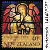 NEW ZEALAND - CIRCA 1995: A stamp printed in New Zealand, shows Stained Glass Window Depicting Angel with Trumpet, circa 1995 - stock photo