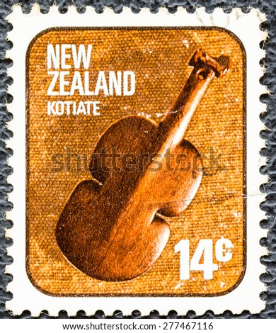 NEW ZEALAND - CIRCA 1976: stamp printed by New Zealand, shows kotiate,local  music instrument, circa 1976 - stock photo