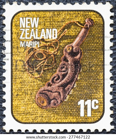 NEW ZEALAND - CIRCA 1976: stamp printed by New Zealand, shows Maripi, carved flute, circa 1976 - stock photo