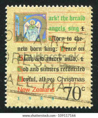 NEW ZEALAND - CIRCA 1988: stamp printed by New Zealand, shows Written Christmas Carol and a Picture of an Angel, circa 1988 - stock photo