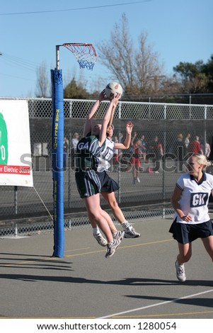 New Zealand Club netball Action, Premier Grade.  Greenpark's Aimee Lanauze and Goal Defence for Southbridge, Jonelle Foster jumping for a high pass in the 2nd quarter. - stock photo