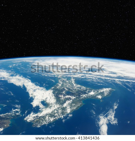 New Zealand from space with stars above. Elements of this image furnished by NASA.  - stock photo