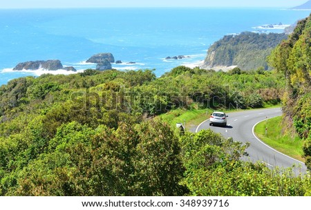 New Zealand Haast Highway: A scenic road winds along the western shore of New Zealand's South Island. - stock photo