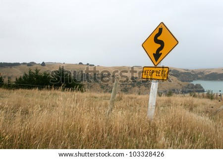 New Zealand Landscape with Keep Left Sign in the Foreground - stock photo