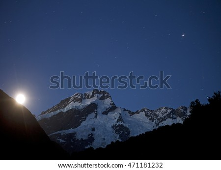 New Zealand - Mount Cook in night with a moon and stars