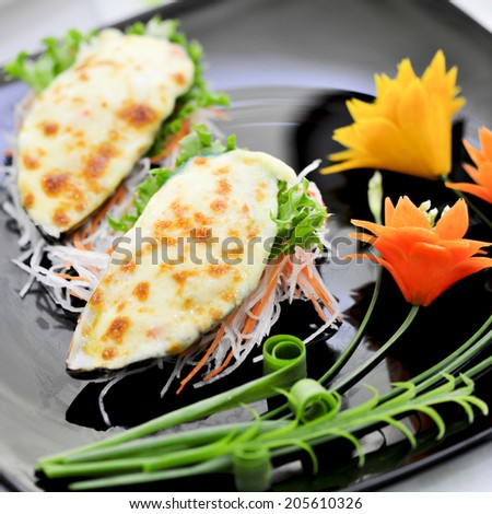New Zealand Mussels with Cheese - stock photo