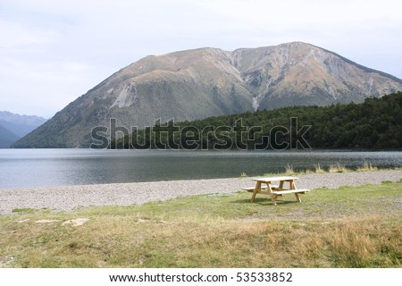 New Zealand. Nelson Lakes National Park - empty bench. - stock photo