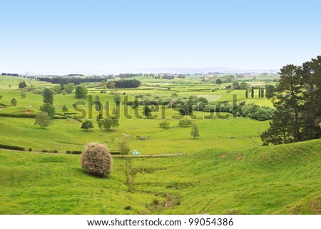 New Zealand pastures in a Farmland Valley - stock photo