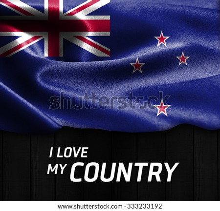 New Zealand waving flag with Text I Love My Country on wood texture background - stock photo