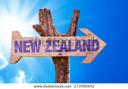 New Zealand wooden sign with sky background - stock photo