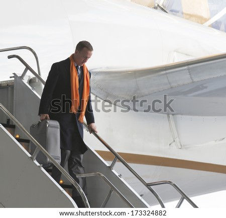 NEWARK, NJ - JANUARY 26, 2014: Denver Broncos Peyton Manning arrives on United flight 1825 charter Boeing 767-400 plane at Newark Liberty Airport for the NFL Super Bowl XLVIII football game