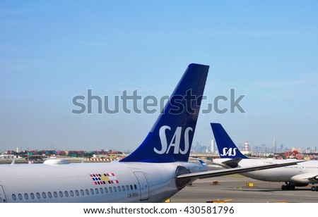 NEWARK, NJ -1 JUNE 2016- Two airplanes from the Scandinavian airline SAS (SK) at Newark Liberty International airport (EWR) with a view of New York City in the background.