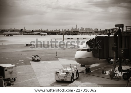 NEWARK, NJ - MAY 11: Airplane at airport with New York City skyline on May 11, 2014 in Newark, New Jersey. Newark airport is the 10th busiest in US. - stock photo