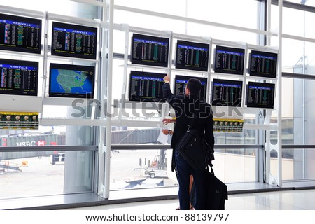 NEWARK, NJ -  OCT 5: Passenger check flight info on October 5, 2011 in Newark, New Jersey. Newark airport near New York City is 10th busiest in US and the 2nd-largest hub for Continental Airlines. - stock photo