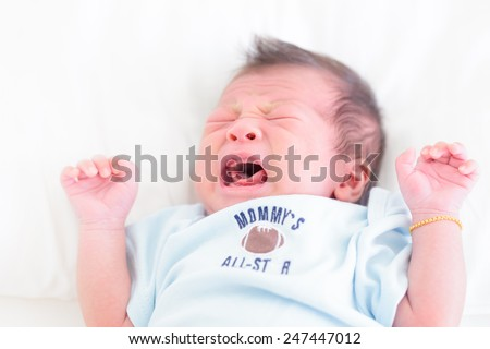 Newborn asian baby cry - stock photo