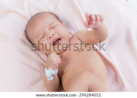 Newborn Asian baby crying, 76 days after birth - stock photo