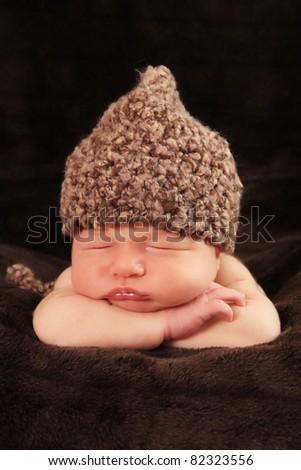 Newborn baby boy asleep on a blanket. - stock photo