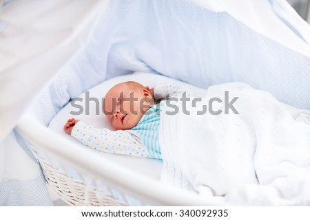 Newborn Baby Boy In Bed New Born Child Sleeping Under A White Knitted Blanket