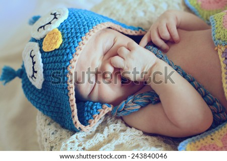 Newborn baby boy in the owl hat - stock photo