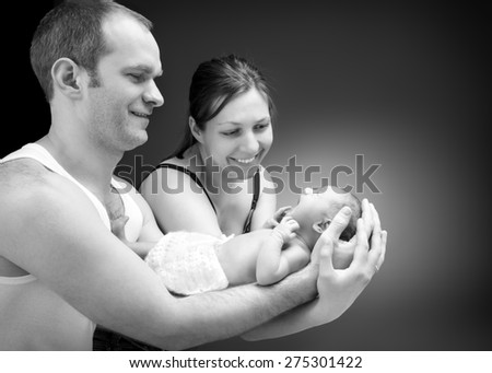 Newborn baby boy on the father's and mother's hand. - stock photo