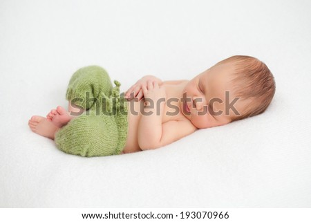 Newborn baby boy on white background - stock photo