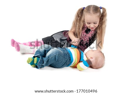 Newborn baby boy with sister - stock photo