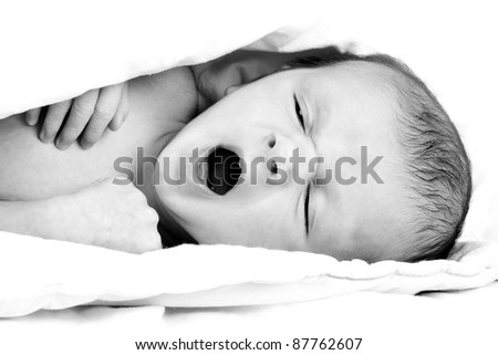 Newborn baby boy yawning - stock photo