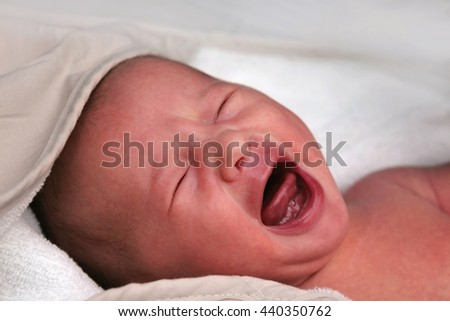 Newborn baby crying after its first bath
