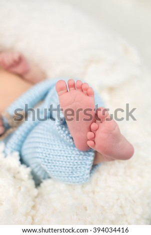 Newborn baby feet, infant and parenting concept; copyspace - stock photo