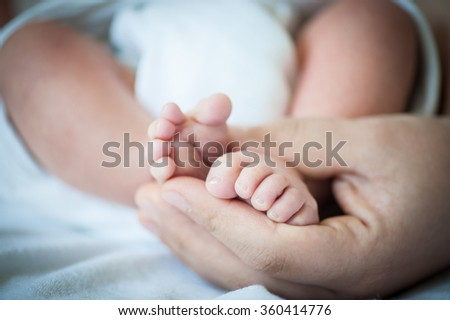 Newborn baby first days of life - stock photo