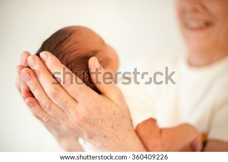Newborn baby first in arms
