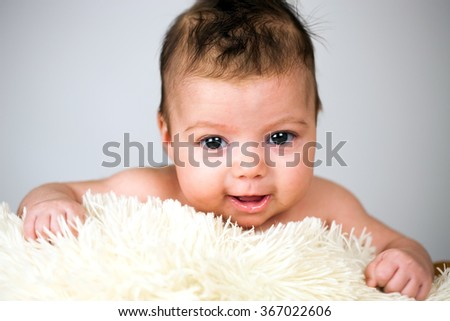Newborn baby girl. - stock photo