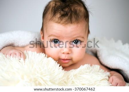 Newborn baby girl. - stock photo
