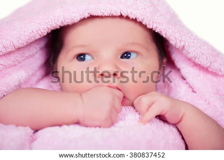 Newborn baby  girl on a soft pink terry towel - stock photo