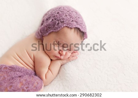 Newborn baby girl posing on white background - stock photo