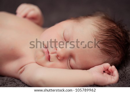 Newborn baby girl right after delivery. Sweet baby girl portrait. Shallow focus. - stock photo