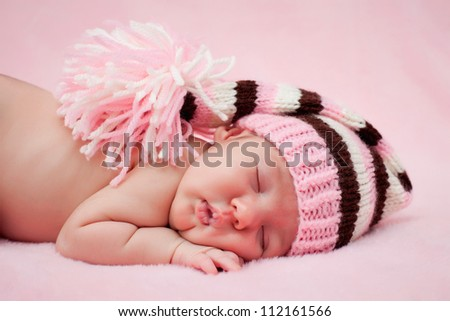 Newborn baby girl right after delivery.Sweet baby girl portrait. Use the photo to represent life, parenting or childhood. Shallow focus.