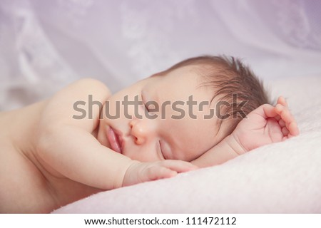 Newborn baby girl sleeping - stock photo