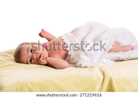Newborn baby girl with congenital torticolis  sitting in fluffy blanket waiting for massage - stock photo