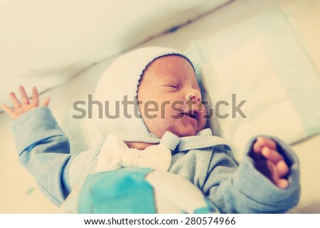 Newborn baby home sleeping - stock photo