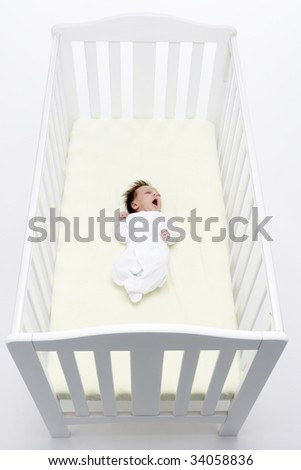 Newborn Baby In Cot - stock photo