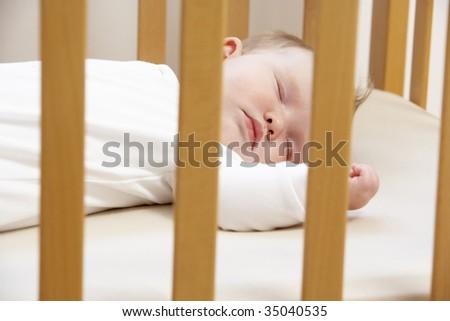 Newborn Baby In Cot - stock photo