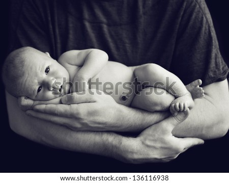 Newborn baby in dad's hands